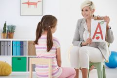 Girl with speech therapist Royalty Free Stock Photography