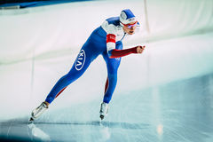Girl speed skaters on a running track skating rink Stock Images