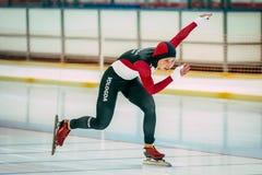 Girl speed skaters runs distance Stock Photos