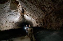 Girl speleologist. Cave in the Pinega region .Arhangelsk region Stock Photography