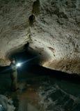 Girl speleologist. Cave in the Pinega region .Arhangelsk region Royalty Free Stock Photos