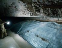 Girl speleologist. Cave in the Pinega region .Arhangelsk region Royalty Free Stock Photo