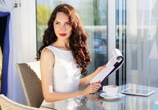 Girl spending time in a cafe using digital tablet Royalty Free Stock Photo