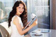 Girl spending time in a cafe using digital tablet Stock Photography