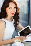 Girl spending time in a cafe using digital tablet Royalty Free Stock Image