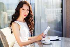 Girl spending time in a cafe using digital tablet Royalty Free Stock Images