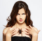 Girl with spider Stock Images