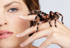 Girl with spider. Close-up portrait of girl with brachypelma smithi spider sitting on her hand Royalty Free Stock Photos