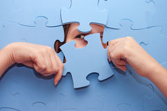 The girl spies through a puzzle Stock Images