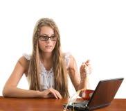 Girl spill coffe to the notebook Stock Photos