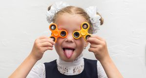 Girl with a spinner in studio stock images
