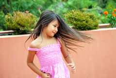 Girl spinning & dancing. Little girl spinning and dancing having fun outside Royalty Free Stock Image