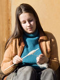 Girl spins a yarn of wool Stock Image