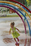 Girl at splash zone Royalty Free Stock Image