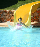 Girl splashes of a water slide Royalty Free Stock Image
