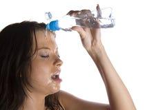 Girl splashing Stock Images