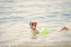 Girl splashing in the sea Royalty Free Stock Image