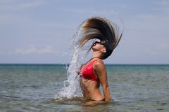 Girl splashing water Royalty Free Stock Images
