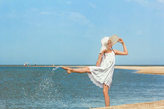 Girl splashing water on the beach Royalty Free Stock Photo