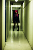 Girl in spooky corridor Royalty Free Stock Image