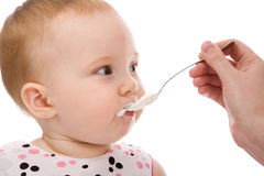 Girl with spoon Stock Photography