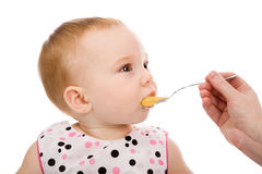 Girl with spoon Stock Photos