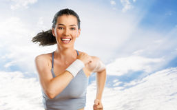 Girl in sport. On the sky background Stock Photo