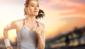 Girl in sport. On the sunset background Royalty Free Stock Image