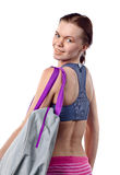Girl with sport bag isolated on white Stock Photos