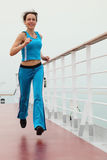 Girl in sport dress running on cruise liner deck Royalty Free Stock Photos