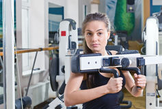 Girl in sport hall Stock Photography
