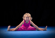 Girl on sport mat Royalty Free Stock Image