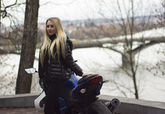 Girl and sport motorbike Stock Photography