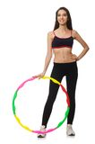 A girl in sport suit with hula hoop isolated on Stock Photography