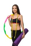 A girl in sport suit with hula hoop isolated on Stock Photos