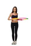 A girl in sport suit with hula hoop isolated on Royalty Free Stock Image