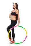 A girl in sport suit with hula hoop isolated on Royalty Free Stock Photo