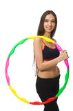 A girl in sport suit with hula hoop Stock Photos