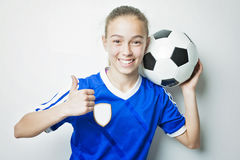 Girl in sport wear with football  on white background. A girl in sport wear with football  on white background Stock Image