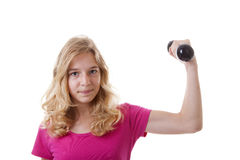 Girl is sporting with dumbbells Royalty Free Stock Images