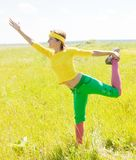 Girl in sporting suit against nature Royalty Free Stock Images