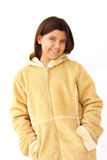 Girl sporting winter coat. Preteen (or early teen) girl sporting warm beige coat. Isolated on white Royalty Free Stock Image