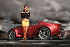 Girl and sports car Stock Photos