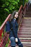 Girl In sports clothes and with a backpack Royalty Free Stock Photography