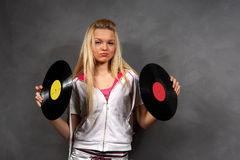 Girl in sports clothes with vinyl Stock Image