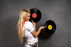 Girl in sports clothes with vinyl Stock Images