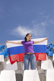 Girl sports fan waving flag Stock Photos