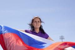 Girl sports fan waving flag Royalty Free Stock Photography