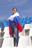 Girl sports fan waving flag Royalty Free Stock Image