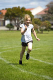 Girl in sports race royalty free stock photography